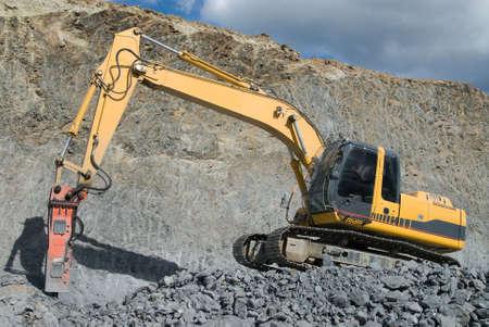 Pre�lufthammer: Gro�e Jackhammer Smashing Rocks