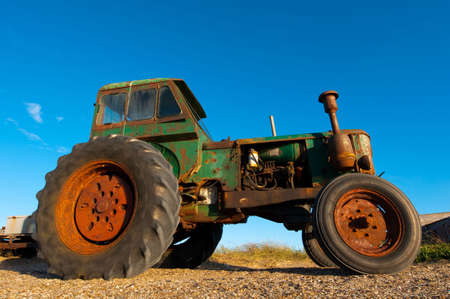 Old Rusty Tractor still working photo