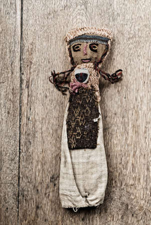 andean: Ancient Andean Doll on wooden table