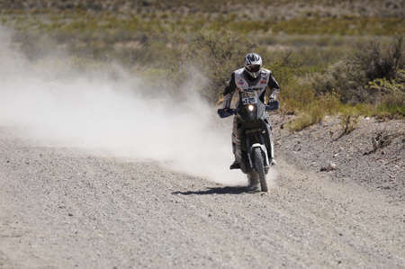 dirtroad: MENDOZA, ARGENTINA - JANUARY 15 2010 - A Motorcycle in the Rally DAKAR Argentina - Chile 2010