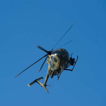 An Armored Combat Helicopter in Flight photo