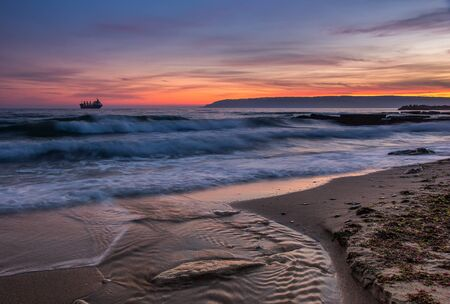 sunny beach: Sea after sunset. Beauty sea beach with slow shutter and waves flowing out.