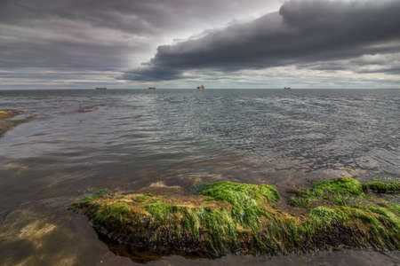 stormy clouds: Beautiful calm sea with amazing stormy clouds