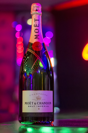 mot: Varna, Bulgaria - May, 30, 2015: Bottle of Moet & Chandon champagne on the table in bar. French fine winery. Editorial