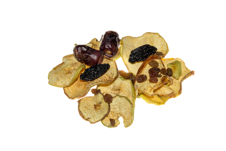 pile of mixed dried fruit prunes, apples, raisins and dates,isolated on white background