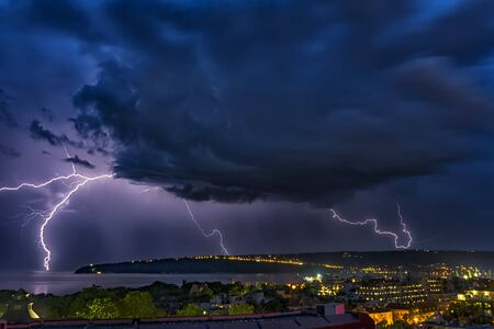 Exciting powerful lightning over the sea, zipper and thunderstorm, Varna. Bulgaria