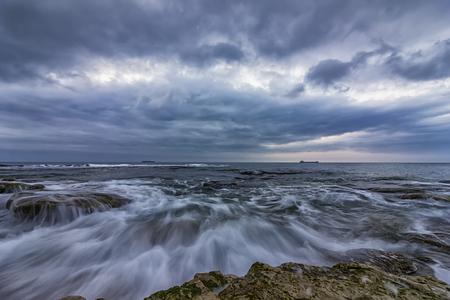Stunning long exposure cloudy sunset seascape. Stock Photo