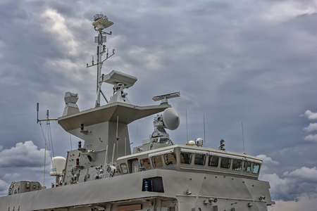 A part of military navy ship. Military sea landscape with cloudy sky