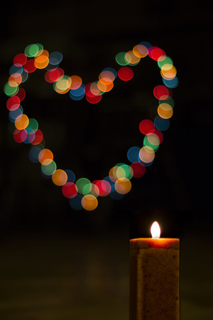 Candles light with bokeh like heart. Abstract candle background.