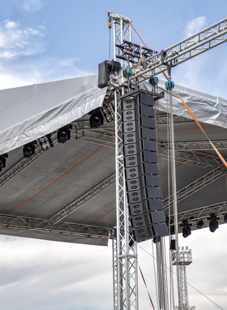 stage lighting and sound equipment on the outdoor stage before a concert