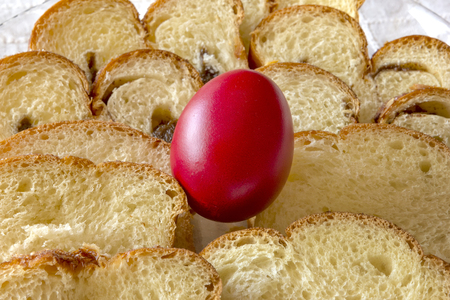 Easter traditional bread and red chicken egg in a plate on the table Stock Photo