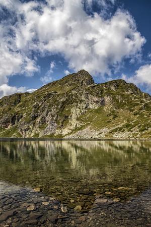 Beauty landscape reflection of mountain hills in the lake, Rila mountain, Bulgaria