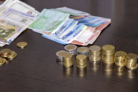 many banknotes and coins, lev and euro on the table ready for traveling Stock fotó