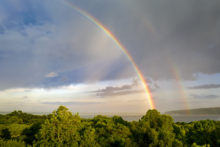 Stunning two big rainbows after the rain over the sea