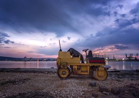 Amazing view at small roller at a construction site in a beautiful twilight Imagens
