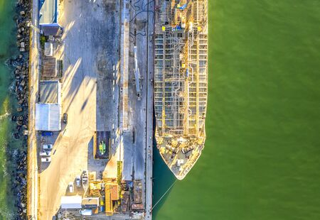 A part of a tanker of the city port. Aerial top view from a drone. Concept export ship