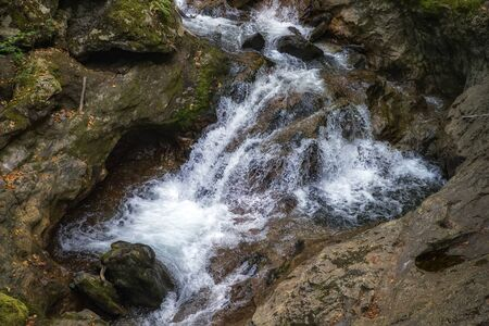 Scenic view of amazing water stream between rocks. Close up