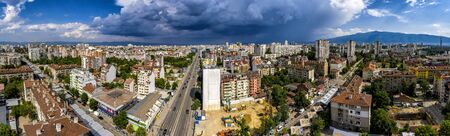 Amazing aerial panorama from a drone of city Sofia with stormy clouds, Bulgaria