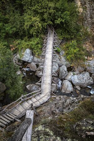 Beautiful wooden hand-made bridge in the eco path White River, near Kalofer, Bulgaria. Nature preservation while giving people access is the goal.