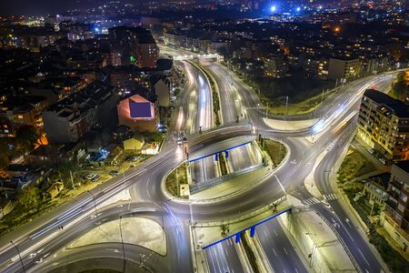 Amazing circle junction traffic road with car light movement aerial view from a drone.