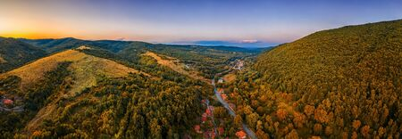 Panoramic Drone Aerial View view of mountain peaks and road between them. Autumn landscape Reklamní fotografie