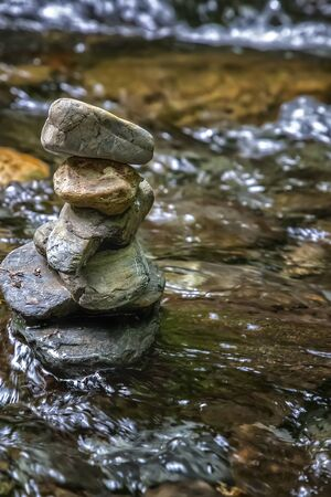 Zen balancing pebbles from river stones stack. Tranquil Concept. Vertical view