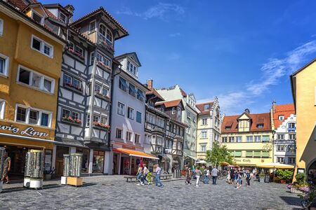 Lindau, Germany - July 21, 2019: Square of Old Town with amazing old houses and people during a weekend day.