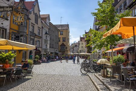 Lindau, Germany - July 21, 2019: Streets of Old Town with tourists and residents during a weekend day. Editöryel