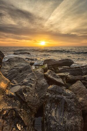 Stunning sea sunrise among the rocks at the Black Sea shore near Varna, Bulgaria