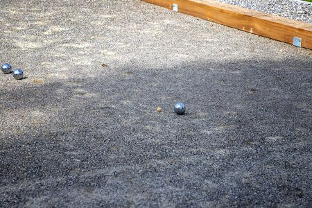 Petanque balls in the playing field, Ball of petanque is iron for a throw at relaxing time Stock Photo