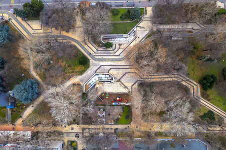 top view from drone of city park walkways and trees. Architecture element