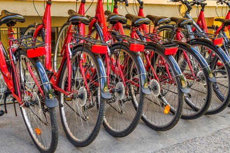 Varna, Bulgaria - May 29, 2020: Bicycle parking station full of bikes. Many parked bicycles