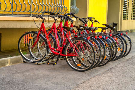 Varna, Bulgaria - May 29, 2020: Bicycle parking station full of bikes. Bicycles for rent Sajtókép