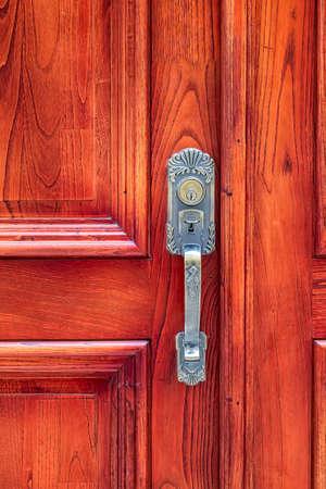 Door knocker. New design knocker on the wooden doors for knocking. Vertical view