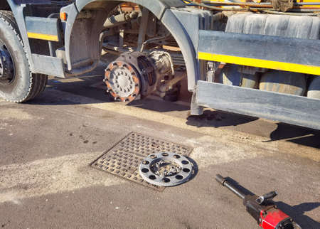 Changing wheel on truck with pneumatic wrench