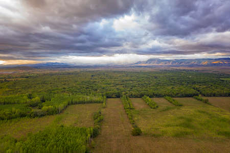 Amazing wide aerial view from drone of beautiful green countryside, mountain hills, and colorful sky 版權商用圖片