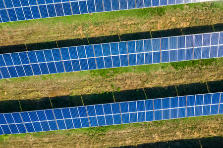 Aerial top view from drone to lines of solar panels.