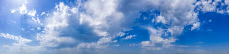 Panoramic view of blue sky with clouds.