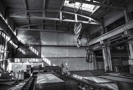 Factory with industrial machinery. Black and white view. Horizontal view