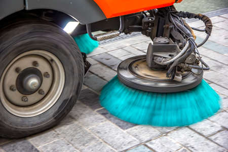 Sweeper truck, vehicle cleaning machine, clean urban road the streets in the city. Close up
