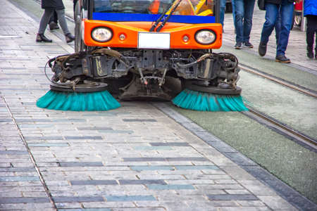 Sweeper truck, vehicle cleaning machine, clean urban road the streets in the city. Concept Foto de archivo