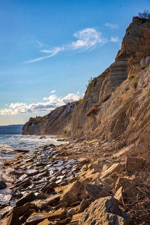 At a stone coastline at the Black sea. Vertical view. 版權商用圖片
