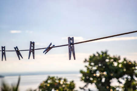 Clothespins holding clothes in laundry. clothespin on a string in a balcony. Abstract view