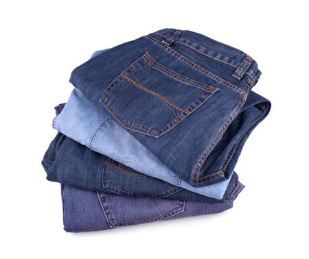 fold back: Stack of jeans isolated on white background.