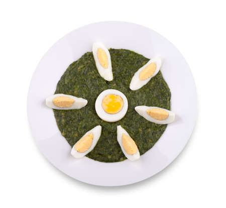 Spinach with boiled egg Stock Photo