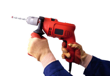 gloved: Gloved hands with electric drill