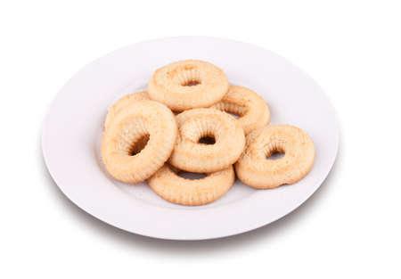 A few tea cookies on a plate