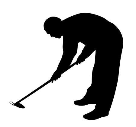 Man working in the garden with weeding hoe