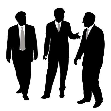 Group of three businessmen walking and talking