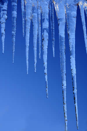 beautiful icicles against a backdrop of the sky Stock Photo
